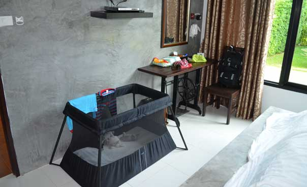 Bedroom with travel cot