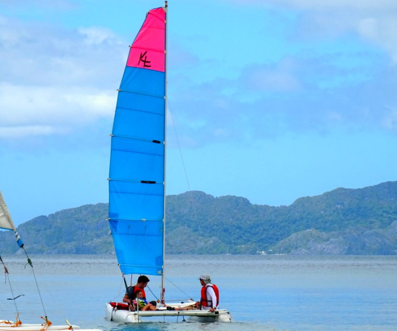 Sailing a catamaran in El Nido. The Philippines with kids