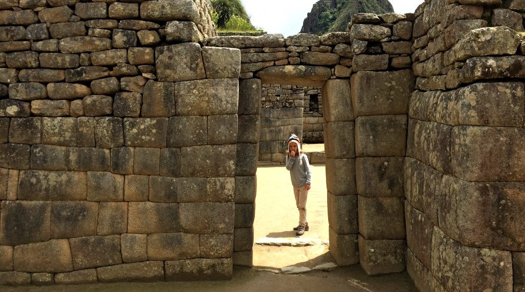 Trapezoid shaped doors to resist earthquakes at Machu Picchu. With kids.