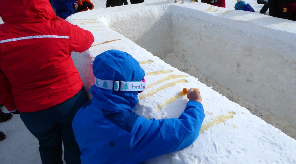 Image of rolling maple taffy on the snow at the Québec Winter Carnival