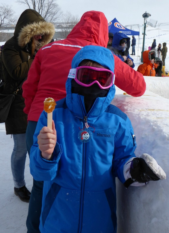 Image of eating maple taffy at the Québec Winter Carnival