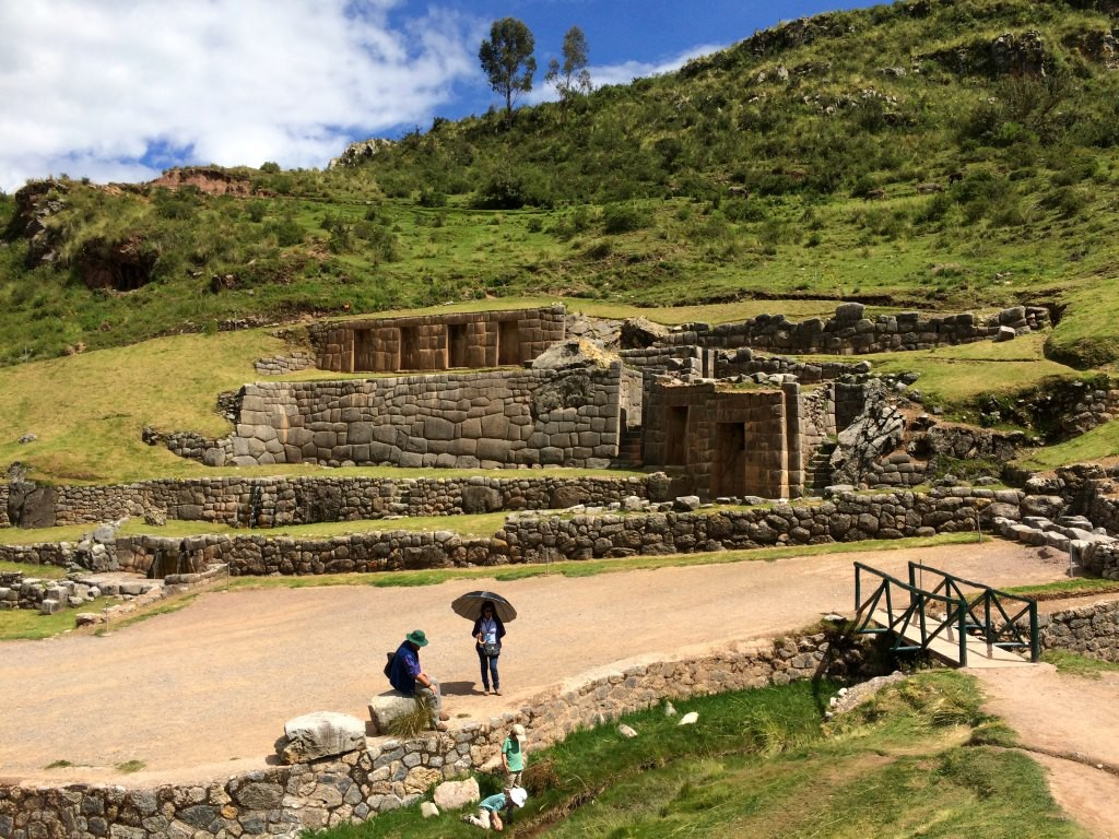 Playing in the steam at Tambomachy, Cusco, Peru