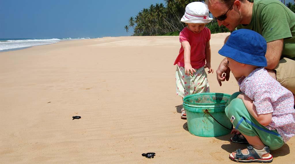 Children releasing turtles into the sea, Sri Lanka Family Holiday